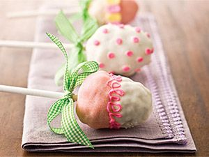 Make these easy Easter egg pops by shaping Rice Krispie Treats into eggs, placing them on a lollipop stick, and decorate them with frosting.