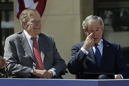 Former President George W. Bush, wipes a tear after his speech during the dedication of the George W. Bush Presidential Center Thursday, April 25, 2013, in Dallas. Left is President George H.W. Bush. (AP Photo/David J. Phillip)