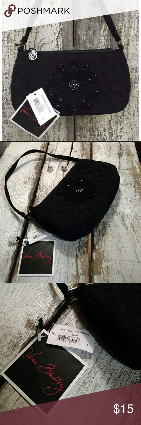 Black GiGi Bag🌼 Black Microfiber GiGi Vera Bradley Bag. The dimensions are 8 3/4 x 4 3/4 x 2 1/4.  Vera Bradley Black Microfiber GiGi handbag. The GiGi evening bag sports a suede posy, accented with jet black crystal beading, so cute. It has silver VB zipper pull and accents, plus a slim little strap. Vera Bradley Bags Mini Bags