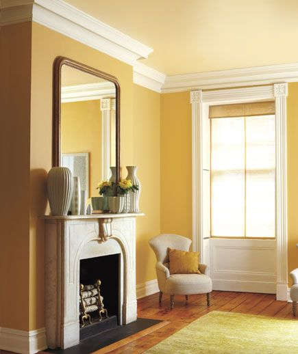 """golden tones are easier to work with than lemony tones, which can be too intense and have a 'highlighter' effect."" With a ""suite"" of closely related shades—from the ceiling to the rich wood floor"