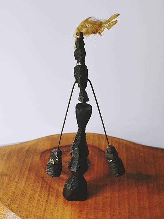 Check out this item in my Etsy shop https://www.etsy.com/ca/listing/557005357/african-wood-balancing-toy-hand-carved