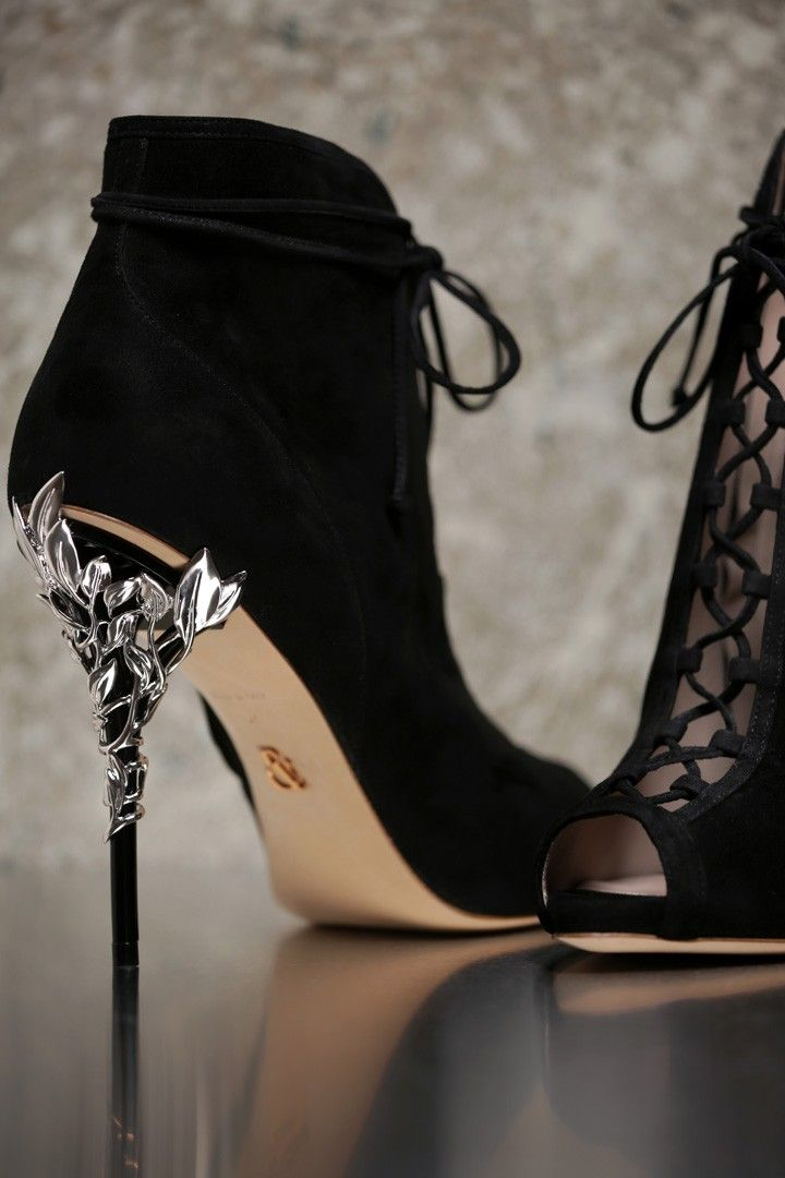 <p>With ornamental filigree leaves spiralling naturally up the heel, this Black Suede Eden Open Toe Ankle Boot harks back to the beauty and perfection of a lost paradise. As if from an enchanted fairy-tale, entangled in the dense foliage of the forest and claimed by a wandering damsel, the Eden Ankle Boot is celestial, refined and romantic.</p><p>The Eden Open Toe Ankle Boot is part of an exclusive preview of our new accessories collection, as featured in the AW16/17 Couture Show. For more…