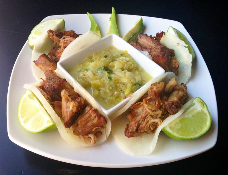 Carnitas roasted in a slow cooker and then wrapped in thinly sliced jicama taco shells.
