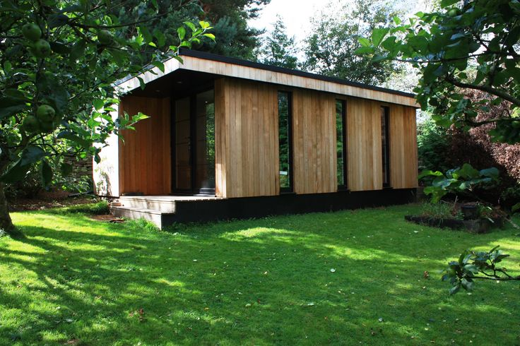 Garden rooms, a bespoke games room in the garden with high levels of sound and thermal insulation, specific and bespoke design with full-length feature windows.