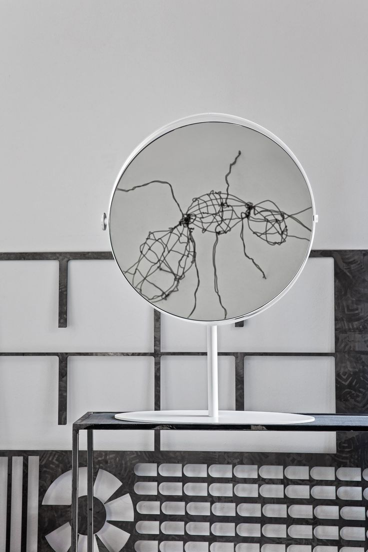 The 19th-century style mirror is reinterpreted with a contemporary twist. KIOO is a large round mirror with adjustable inclination by means of the side knob. It's minimalist with a matt-coated metal frame and can be used in any environment throughout your home. #calligaris #toronto #code