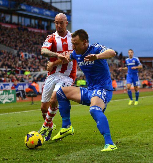 John Terry of Chelsea FC against Stephen Ireland of Stoke City