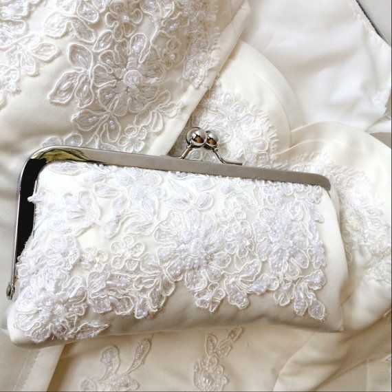 Repurposed wedding gown clutch - The perfect way to create a keepsake out of your mothers, or someone very special to you, wedding gown. by PaperFlora