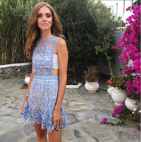 Chiara Ferragni wears a pastel blue dress with a white bralette and stacked jewelry