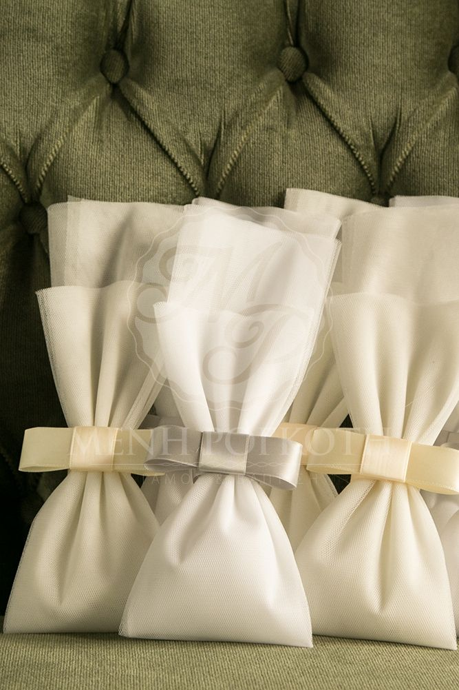 Wedding favor made from white tulle with grey or ivory channel bow. #stylefashionweddings #weddingfavor #channelbow