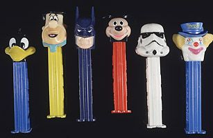 After the candy itself caught on, Oscar Uxa invented the famed PEZ dispenser in the 1950s, but he did not receive acclaim for his creation until heads were placed on top of the dispensers in 1955.