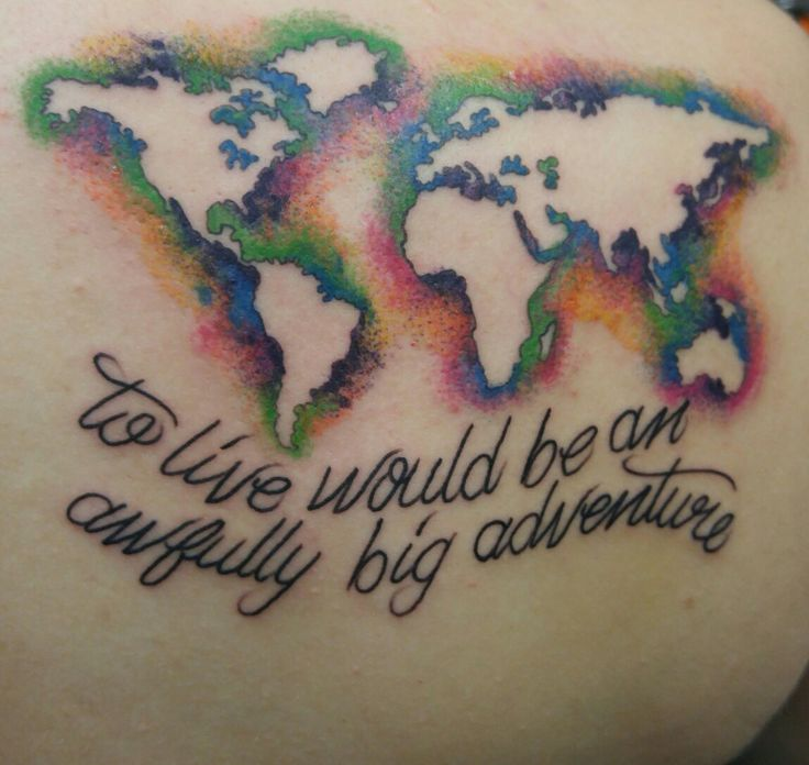 Negative space world map tattoo with peter pan quote