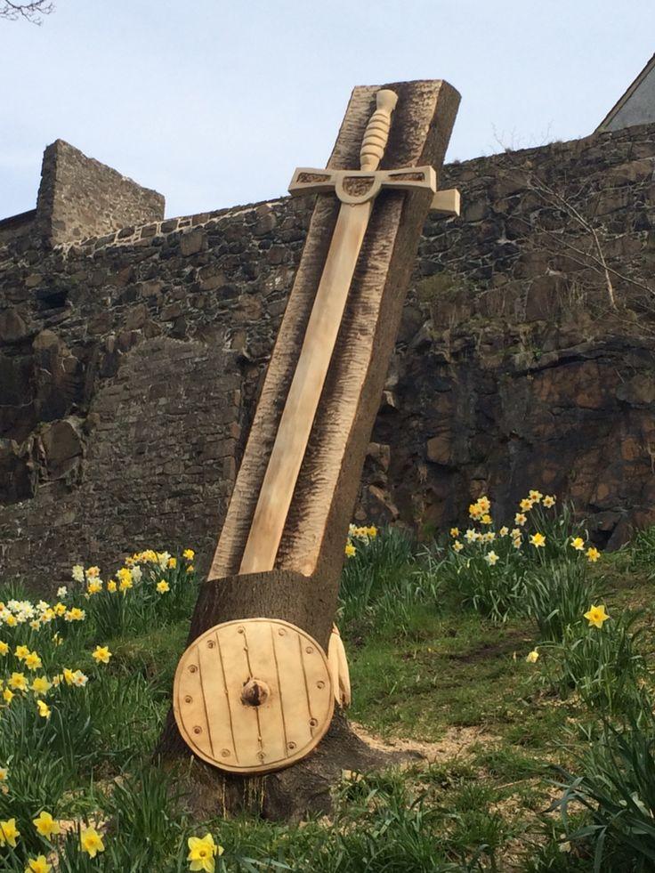 Carved wooden sword and shield on back walk, Stirling