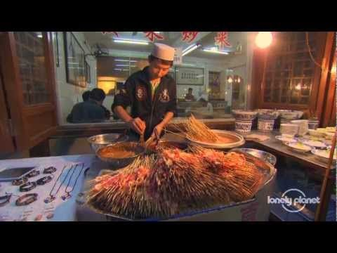 Street food of Xi'an, China - Lonely Planet travel videos - http://bookcheaptravels.com/street-food-of-xian-china-lonely-planet-travel-videos/ - Once the eastern terminus for the Silk Road, Xi'an's local foods have been influenced by travellers from far and wide. Visit  - adventure, Asia, biang, china, Destination, Food, lonely, muslim, persimm, planet, quarter, Road, silk, stall, street, tourism, Travel, vendor, xian