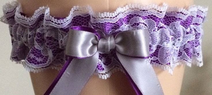 This listing is for a Purple and White Lace Wedding Garter that can be worn at Weddings, Bridal, Costume, and Proms! This garter is available in Regular and Plus Size! The garter includes: 1 Keepsake