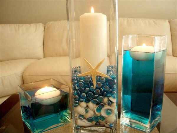 Add sand to mason jar dye water to aqua floating candle .. No stones