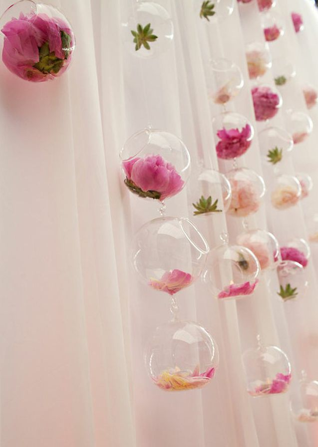 hanging vases orbs flowers pink peach green succulents