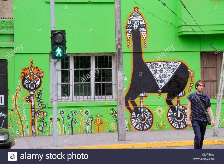 Santiago Chile Barrio Patronato Avenida Santa Maria immigrant neighborhood mural street art artist Juanita Perez Bicicleta Verde Stock Photo