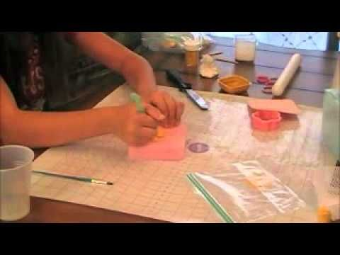 How to make 2 gum paste flowers  this video tutorial is taught by a 13 year old but it is very helpful and i just learned to make a calla lylli