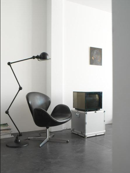 Polished concrete floor. Jiélde, Swan chair and cube tv.