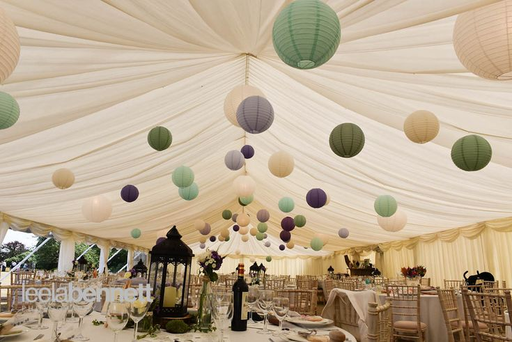 Colourful paper lanterns fill this pretty wedding marquee with atmosphere ... #paperlanterns #weddingmarquee #lanterns #bluenandgreentheme