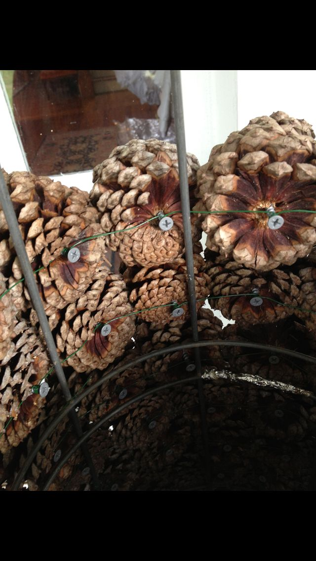 Pine cone tree made from tomato cage, screws, floral wire
