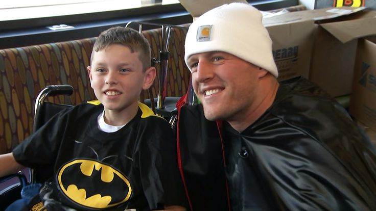 See Houston Texans star J.J. Watt dressed as Batman for a surprise visit to the Texas Children's Hospital for a Halloween party.