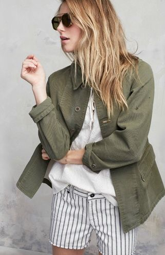 Green canvas jacket, striped cut-offs, long blonde hair, and sunnies - transition from winter to spring.