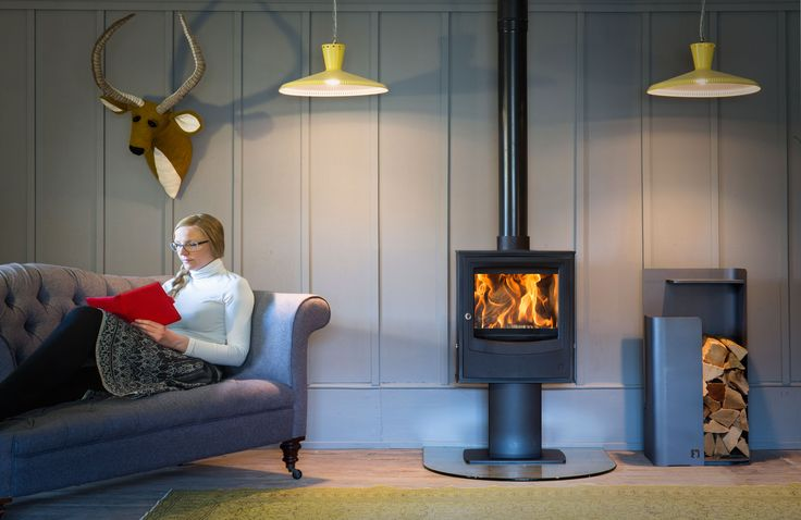 Arada Farringdon Wood Burning stove on optional pedestal stand, makes a stylish statement in your home. Matched with the  Arada Tower Log Store option for neat way to store logs for your cosy evening indoors.                                                                                                                                                                                 More