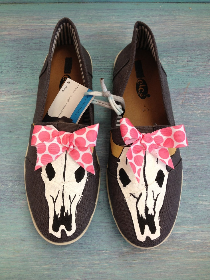 Adorable Hand Painted Canvas Shoes (Toms Style) with Cow Skull & Bow. $35.00, via Etsy.