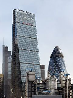 """122 Leadenhall Street, London, UK - Leadenhall Building (informally known as """"The Cheesegrater"""" because of its distinctive wedge shape) with the Heron Tower and 30 St Mary Axe in the background and the Lloyd's building in front. Viewed from the Monument in 2014."""