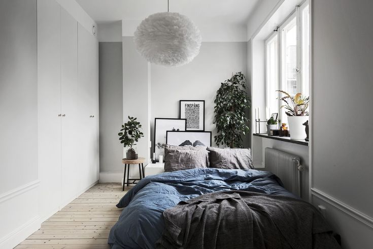 Small grey and blue bedroom