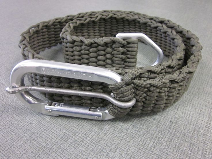550 Paracord Belt With Carabiner Buckle - A one and three quarter inch wide paracord belt with a removable 3000lb carabiner at one end and a 2500lb triangle D-ring at the other. The webbing should be good for around 7000lb, with the seven down and back runs. The whole belt comes apart with a quick undo of the knot hidden behind the D-ring, giving you just over 100' of paracord.
