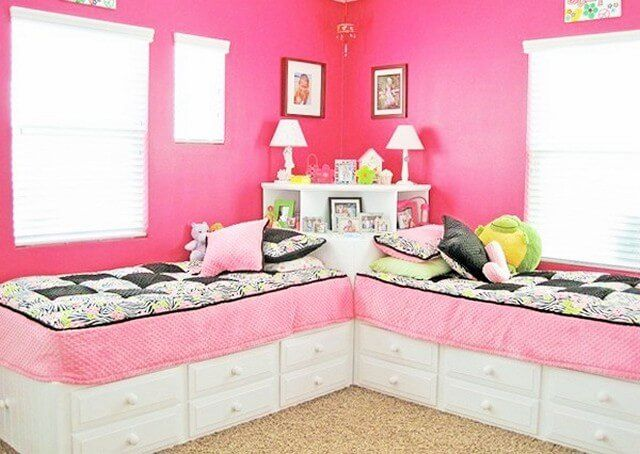 Here in the picture, you can see an excellent bedroom for two individuals. The bedroom has a pink wall paint along with zebra printed bed sheets. Some lamps are placed around the walls and sceneries are also present, having such kids room in the house is a perfect idea.