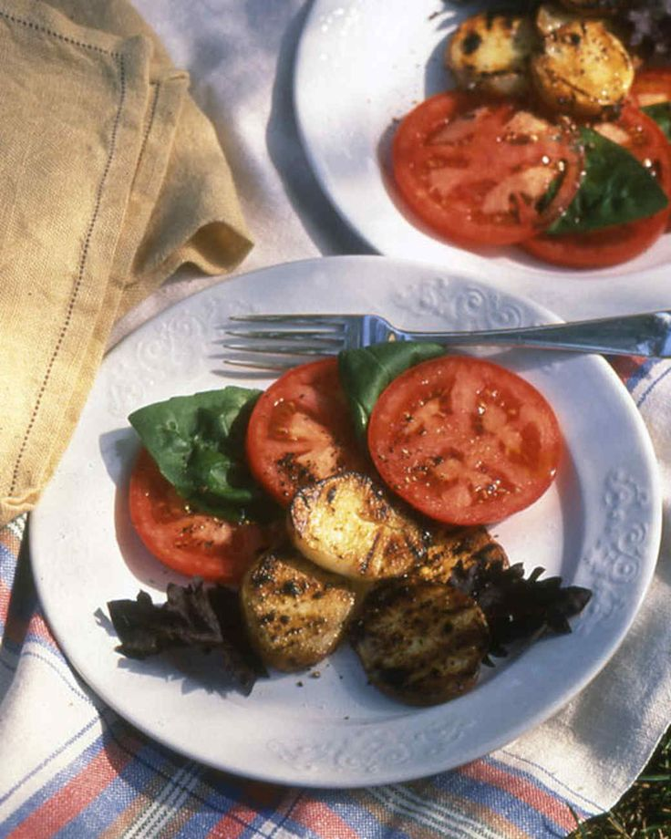 Tomato-Potato Salad with Basil   Martha Stewart Living - The potatoes taste best hot off the grill with the cool tomatoes, but they can also be served at room temperature.