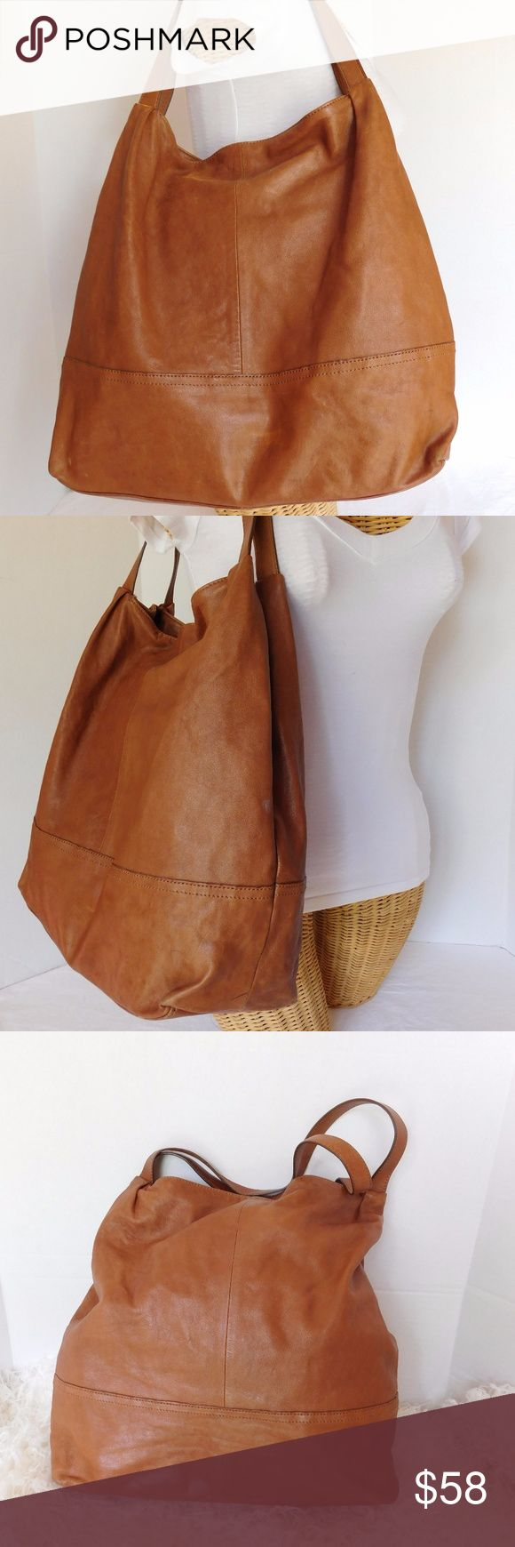 """BANANA REPUBLIC BROWN LARGE SOFT LEATHER TOTE BAG TITLE- BANANA REPUBLIC BROWN LARGE LEATHER TOTE BAG  BRAND- BANANA REPUBLIC  COLOR- BROWN   MATERIAL- SOFT LEATHER   STYLE- TOTE  SIZE- """"16 length, """"15 height, """"5.5 width, """"10 strap drop  FEATURES- 1 LARGE OPEN COMPARTMENT, 1 SLIP POCKET  CONDITION- PRE-OWNED GOOD, WORN LEATHER LOOK, LITE PEN MARK, RUBBED BOTTOM CORNERS.  Bin- PB18 Banana Republic Bags Totes"""