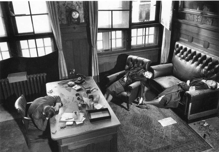 Margaret BOURKE-WHITE: Leipzig City Council deputy mayor Dr. Kurt Lisso, member of Nazi party since 1932, lying dead at his Town Hall desk [a suicide from cyanide], along with his wife and daughter, as American soldiers enter the city at the end of WWII. Leipzig, Germany, April 13th, 1945