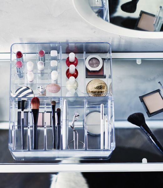 Makeup is organized in a clear IKEA GODMORGON box with compartments.
