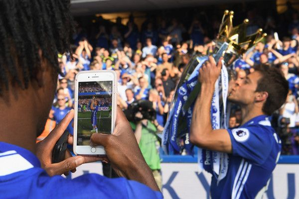 Cesar Azpilicueta Photos Photos - Nathaniel Chalobah of Chelsea takes a picture of team mate  Cesar Azpilicueta and the Premier League Trophy on a phone after the Premier League match between Chelsea and Sunderland at Stamford Bridge on May 21, 2017 in London, England. - Chelsea v Sunderland - Premier League