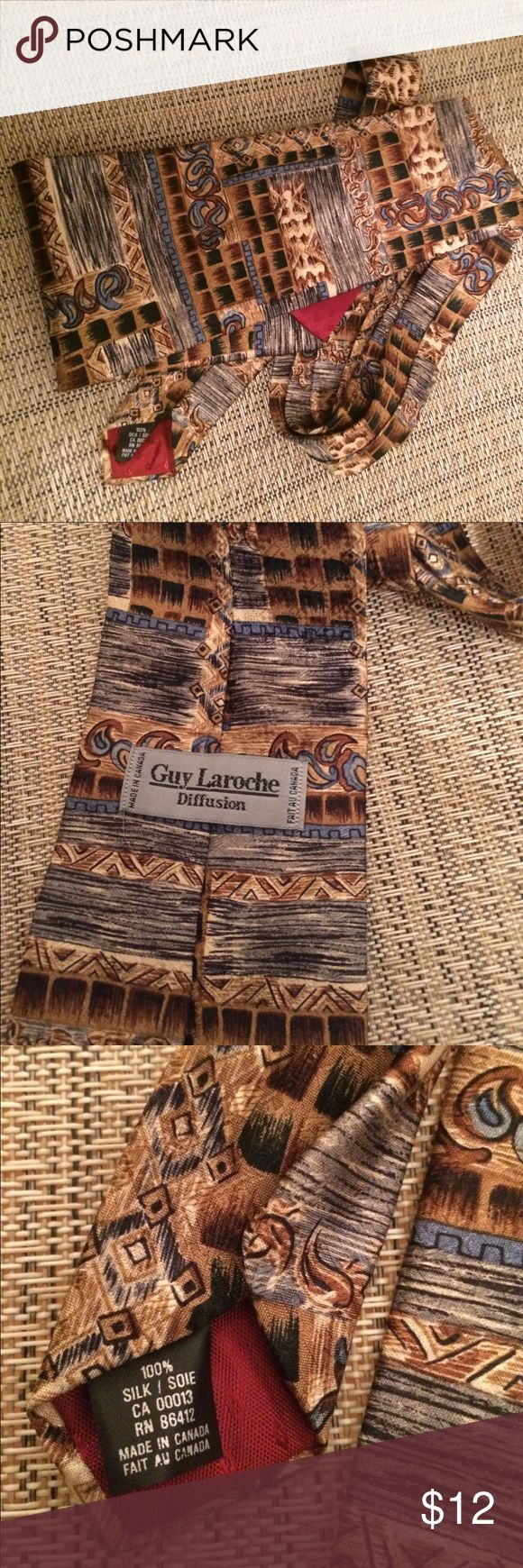 Guy Laroche necktie.  Silk. Geometric design Shades of brown blue gray and black. Made in Canada. Standard length. Excellent condition. guy laroche Accessories Ties