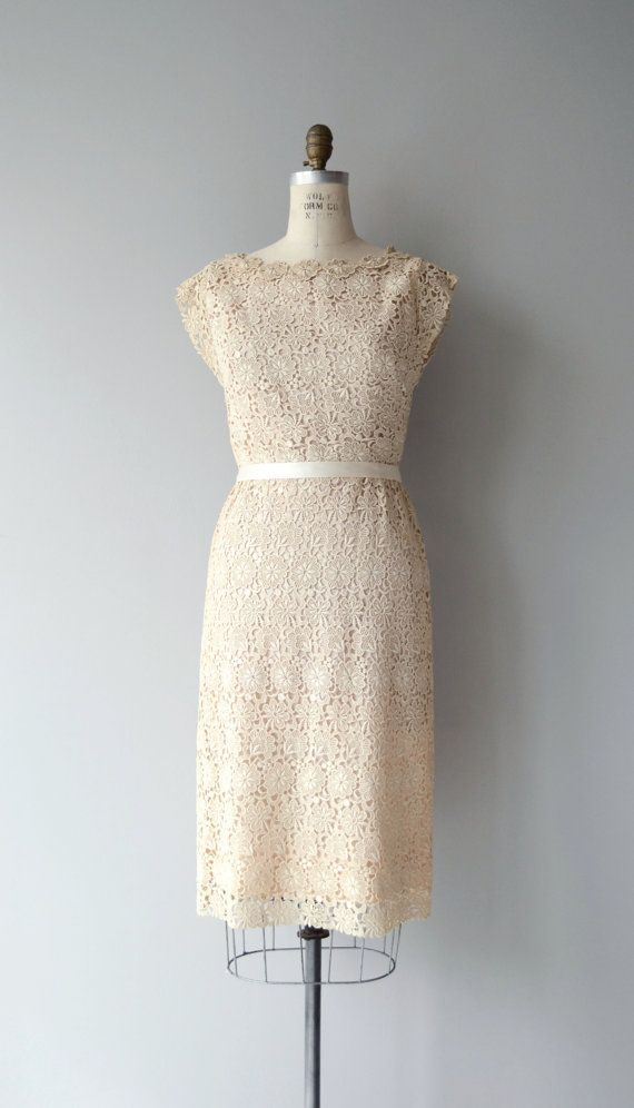 Amazing vintage 1950s Sidney Kramer cream cotton applique lace sheath dress with cap sleeves, fitted waist, lining and long back metal zipper. A really great more casual wedding dress!  --- M E A S U R E M E N T S ---  fits like: small bust: 36 waist: 27 hip: up to 38 length: 42 brand/maker: Sidney Kramer condition: excellent  ✩ layaway is available for this item  To ensure a good fit, please read the sizing guide: http://www.etsy.com/shop/DearGolden/policy  ✩ more vintage dresses ✩…
