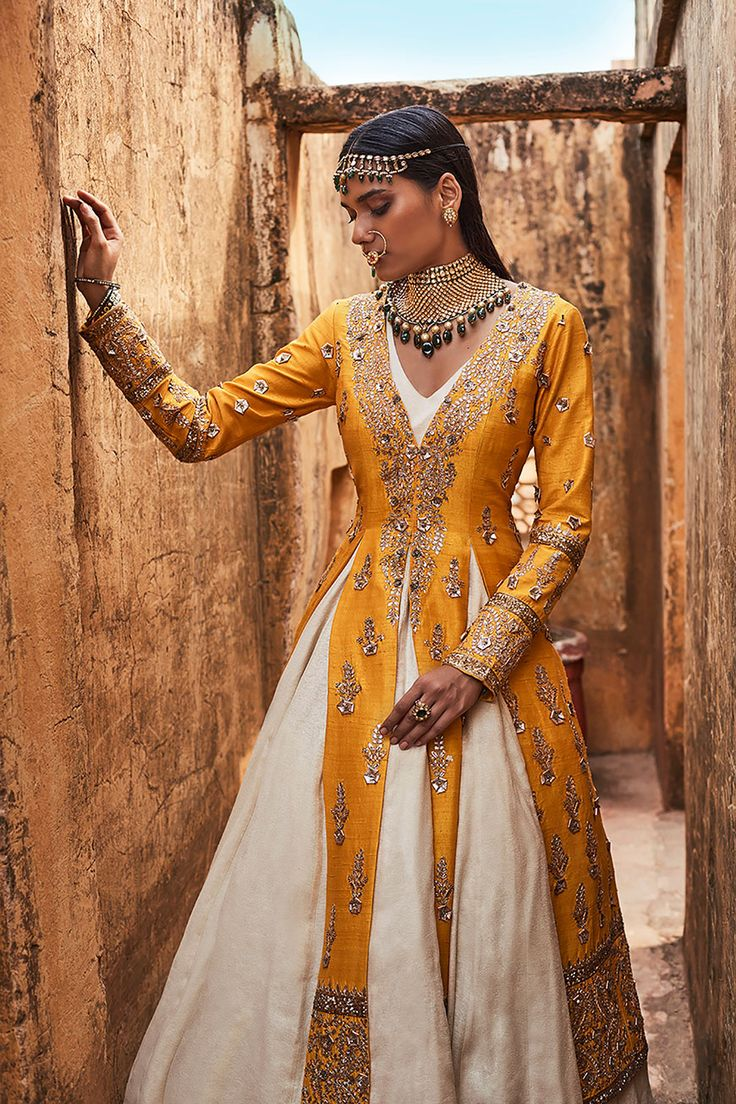 A beautiful paneled jacket with gota patti roses and an anarkali set.                                                                                                                                                                                 More