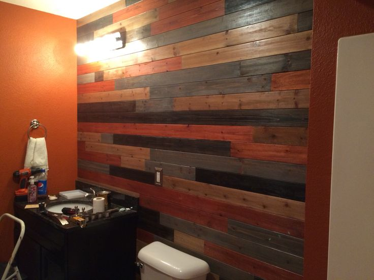 Wood plank wall i used 4 stains a grey gunstock onyx Light burnt orange paint
