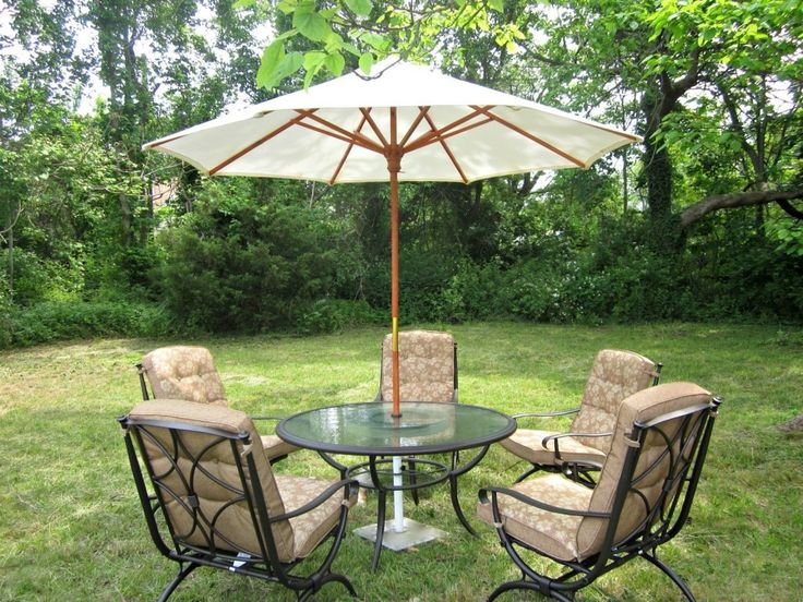 Charming Patio Outdoor Furniture Design With Beige Polyester Cushions On  Black Wrought Iron Frame And Round