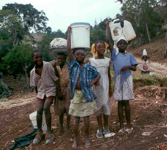 In this picture, Haitian children are seen collecting water.