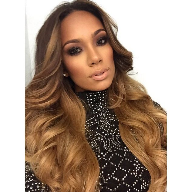 Makeup and hair on Erica Mena.