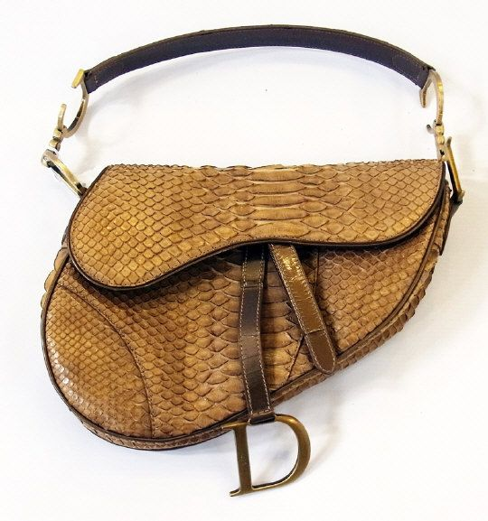 "Christian Dior ""Saddle"" bag, python with authentic card and receipt from Harrods   Estimate £300.00 to £500.00  (Lot no: 168 in sale on 05/08/2014) The Cotswold Auction Company"