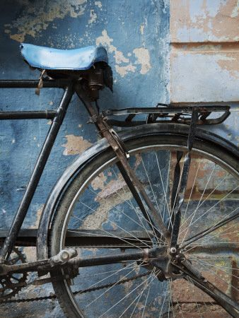 Bicycle Leaning Against Painted Wall Photographic Print at AllPosters.com