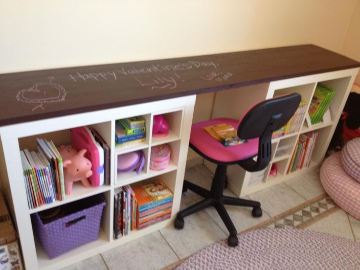 Wanted more storage and writing space for my daughter's desk. So I took two old ikea expedit units, spaced them to fit a desk chair, had a piece of wood cut to fit the top, sanded, added three coats of chalkboard paint...and voila!