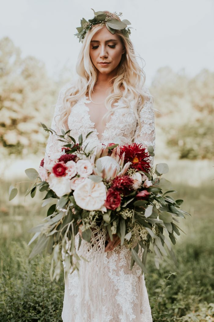 Love this bountiful wedding bouquet of reds and pinks| Image by Vic Bonvicini