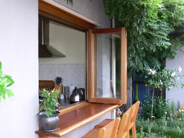 Cedar bi fold window with hardwood servery